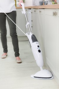 Picture of a woman using a Holme steam mop