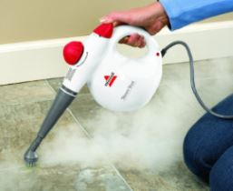 Picture of a Bissell handheld steam cleaner being used on a tiled floor