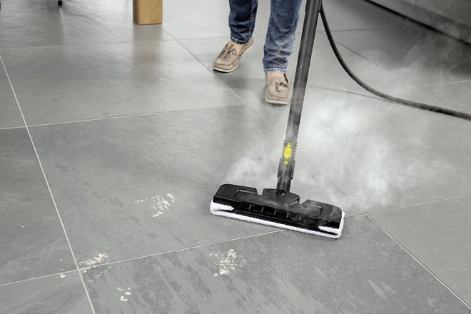 picture of a woman using a karcher steam cleaner on a floor