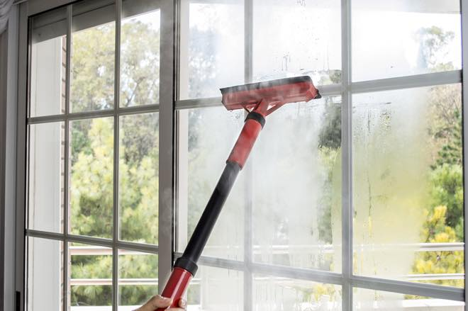 picture of a steam mop being used to clean a window